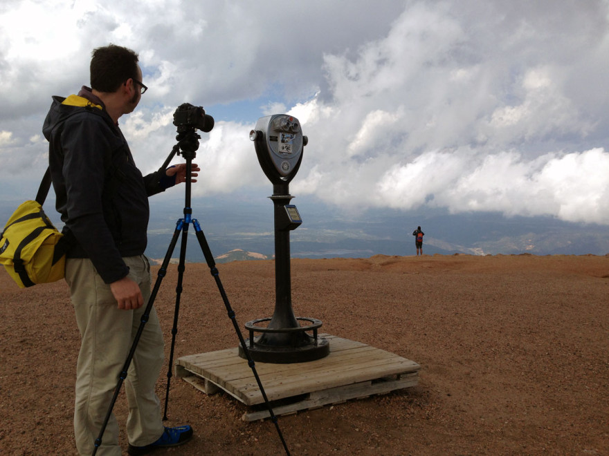Jonathan steadies the camera at the summit of Pikes Peak. Or possibly interviews an alien robot. It's hard to tell.