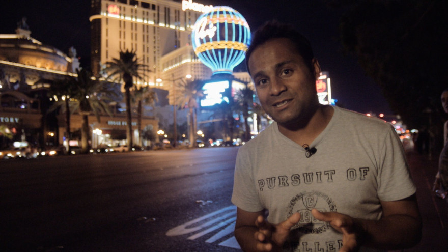 Alom delivers a chunk of script to camera on the Strip.